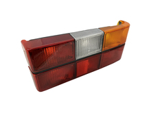 1372450 C Volvo sedan 240, 244, Tail light assembly with black center molding  Right side/Passenger side